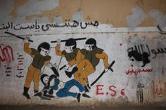 """Graffiti art in Cairo of """"The Blue Bra Girl,"""" an activist who was exposed and beaten by military police while protesting in Egypt last year."""