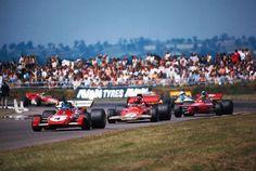 "Jacques Bernard ""Jacky"" Ickx (BEL) (Scuderia Ferrari), Ferrari 312B2 - Ferrari 001 3.0 F12 (RET)Emerson Fittipaldi (BRA) (Gold Leaf Team Lotus), Lotus 72D - Ford Cosworth DFV 3.0 V8 (finished 3rd)Bengt Ronnie Peterson (SWE) (STP March Racing Team), March 711 - Cosworth V8 (finished 2nd)1971 British Grand Prix, Silverstone Circuit"