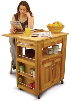 <br><li>Organize your kitchen area with this Heart-of-the-Kitchen storage island<li>Durable kitchen storage constructed of domestic hardwood<li>Versatile kitchen cart features wheels for easy transport
