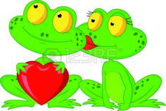 Couples de grenouille de bande dessin�e tenant coeur rouge photo