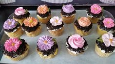 Garden Cupcakes ~ Vanilla cupcakes filled with chocolate pudding, topped with vanilla buttercream, dipped in crushed Oreos, and finished with a piped icing flower.