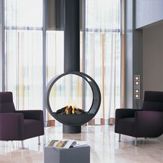 Could this unique, circular fireplace in gas or wood be the piece to complete your project? Get in touch to find out more...  #contemporaryfireplace #fireplace #bespokefireplace #doublesidedfireplace #gasfireplace #interiordesign #luxuryinteriors #contemporarydesign #design #modernliving #architecture #modusfireplaces