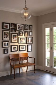 Family photo wall, unified with similar frames and matting