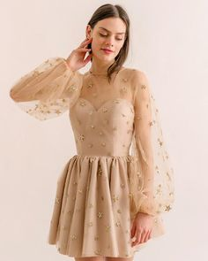 A fun and flirty dress with a twirl-worthy skirt, and embellished with glittery stars all over. Hand wash in cold water, lay flat to dry. polyamide tulle, pvc glitter & stars, environmental protection glue © 2018 LIRIKA MATOSHI INC. ALL RIGHTS RESERVED Long Sleeve Homecoming Dresses, Hoco Dresses, 1950s Dresses, Fashion Designer, Designer Dresses, Gold Party Dress, Dress Skirt, Dress Up, Dress Long