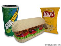 "Last summer I was commissioned by Lay's® to make a sculpture of a Subway® meal consisting of a 6"" sandwich, a fountain drink and a bag of Lay's potato chips to celebrate the two companies' 50 year partnership and to be unveiled at an event in Las Vegas, NV. The sandwich measures 15"" x 36"" and 20"" tall. The cup measures 16"" x 16"" and 34"" tall. The bag of chips measures 6"" x 18"" and 28"" tall. www.BruceLowell.com Follow Bruce on: Instagram 