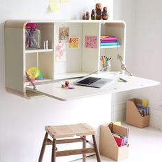 a fold out desk, perfect for the children to do homework etc on & can then be folded out of the way to play!