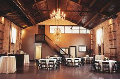 black folding chairs look stunning and chic in this rustic (and a bit industrial) venue setting
