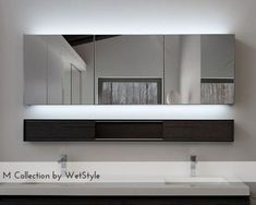 A modern home is based on the type of furniture and fixtures installed in the dwelling. Checkout 25 modern bathroom mirror designs for your inspiration. Decorative Bathroom Mirrors, Contemporary Bathroom Mirrors, Bathroom Mirror Design, Modern Bathroom Cabinets, Bathroom Design Small, Modern Mirrors, Bathroom Ideas, Bathroom Storage, Bath Mirrors