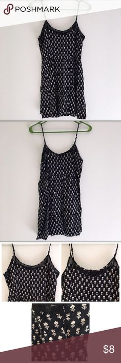Forever 21 Black and Cream Floral Dress Size M Black dress with cream colored floral design. 100% rayon. Lightweight fabric. Sheer trimming along edge of chest. Spaghetti straps. Zipper on side under left arm. Worn a few times and washed. Good condition. Forever 21 Dresses Mini
