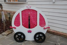 Bill built this carriage for the girl's 3rd birthday party. Just some a simple board of plywood, white spray paint, fabric from Hobby Lobby, adorable wooden cutouts, and viola! Princess cuteness!
