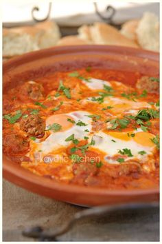 Kefta Mkaouara. Moroccan  Meatballs with poach eggs.