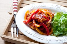 Pork, red and yellow bell peppers dusted in potato starch, salt and pepper, and pan fried in doubanjiang and sesame oil. Mix ketchup, honey, sake, soy sauce, and chicken bouillon and pour on top of chicken and veg and cook until sauce is thickened.
