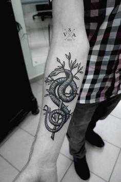 Snake On A Tree Arm Tattoo