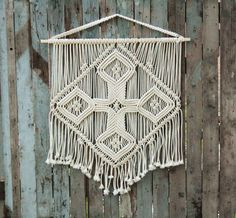 "If you like Celtic crosses or just crosses, one could theme a wall...Macrame wall hanging ""Magic Cross"", $129"