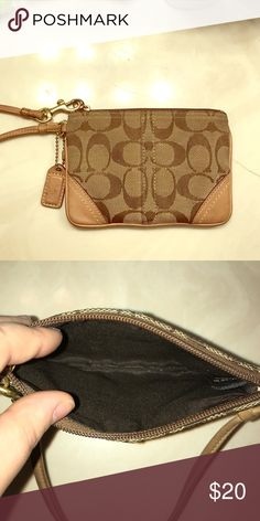"""Coach Signature """"C"""" Brown/Tan Wristlet Coach C Brown and Tan wristlet, used but well taken care of, in fair condition. Coach Bags Clutches & Wristlets"""