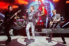 Musicians John Taylor, Simon Le Bon, and Dom Brown of Duran Duran perform on stage at Cal Coast Credit Union Open Air Theatre on September 27, 2015 in San Diego, California.