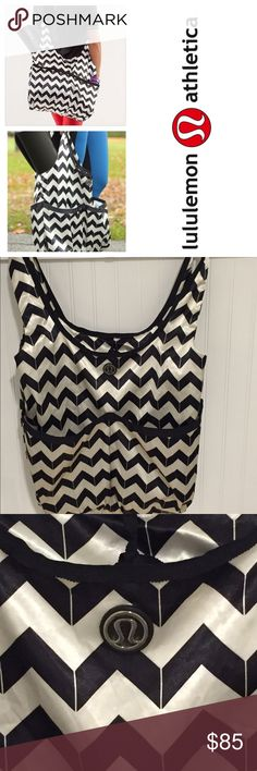 Lululemon black white chevron tote bag Used a few times. One small spot in the back but in otherwise great condition. Made of a satin type fabric. Optional black strap makes the bag an overcthe shoulder sling. lululemon athletica Bags Crossbody Bags
