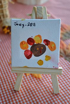 adorable fingertip turkeys on tiny canvases ... @Amanda Huggins, wouldn't that be fun for playgroup next year?