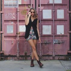 Get this look: http://lb.nu/look/7312014  More looks by Jasmine M: http://lb.nu/jasministic  Items in this look:  Thrift Store  Black Vest, Thrift Store  Floral High Waisted Shorts, Dr. Martens Doc Martens, Round Sunglasses, Anne Klein  Leather Brand Watch