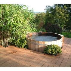 Ofuro Japanese soaking tub = something my father might need after living on the farm for a while? Northern Lights Cedar Tubs hot tub picture gallery gives unique ideas from installing to use of your own cedar hot tub at home. Japanese Bathtub, Japanese Soaking Tubs, Outdoor Tub, Outdoor Baths, Outdoor Dining, Dining Area, The Farm, Stock Tank Pool, Tub Shower Combo