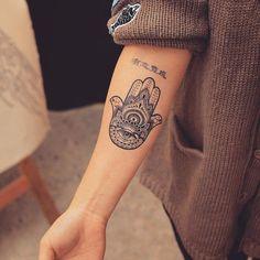 Spiritual forearm hamsa tattoo