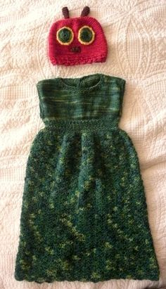 Hungry Hungry Caterpillar knitted  crocheted outfit that I made for a friend's little girl on her first birthday.  The hat I mostly made up. The link with the patterns and alterations for the dress can be found here: http://www.ravelry.com/projects/homegrownrose/sadie-baby-dress