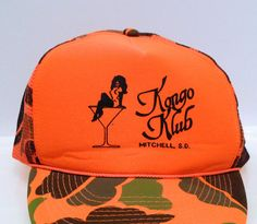 Vintage Kongo Klbu Trucker Cap with Adjustable Back Strap -- Classic Camouflage 1990s Tags/ID Marks/Labels: One Size Fits All, 100% Polyester, 100% Nylon, Otto Cap Condition: Very good Vintage Condition - does not appear to have been used much - possibly never worn. The interior lining of the cap looks great. Very light cigarette smell -- from being on sale at the club. Preowned. We have been collecting vintage clothing and objects for years and owned two Mohawk Music record stor...
