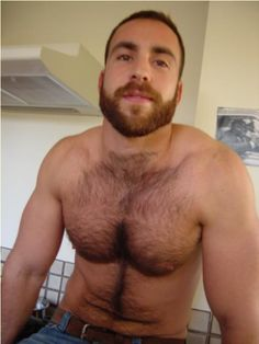 I don't know who this is but I'm gonna marry him, his beard, and his chest hair!!!