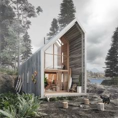 Small home in forest. I like the extended roof as protection from adverse weather and deck.