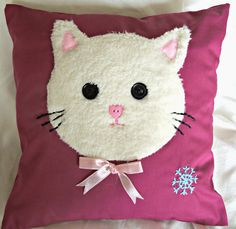 This white cat cushion is a great present for Christmas or any other occasion for your friends, family or yourself! It is cute and lovely. The design is original and you will not find any other cushion like this! It is completely hand-sewn which makes it unique. It is lovingly stitched up into fun little cushion and the free motion applique technique is used on the cover. The cushion is made with various fabrics on a lovely dark red background, the cat face is fluffy and cute.  The cushion…
