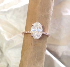 Oval engagement ring. featuring diamonds and Forever brilliant moissanite. pink gold by MichaelPatrickHogan on Etsy https://www.etsy.com/listing/204547229/oval-engagement-ring-featuring-diamonds