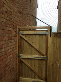 The fencetop cat barrier can be fitted to gates by protectapuss, via Flickr