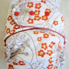 Check out LotusBumz.com for ADORABLE, affordable, sustainable cloth diapers ~ Handmade & Fitted