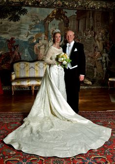 Princess Nathalie zu Sayn-Wittgenstein-Berleburg and husband Alexander Johannsmann pose for their official wedding portrait on 18 June 2011 in Bad Berleburg, Germany