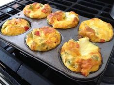 Crustless Quiche Cups - grab and go breakfast! Perfectly pre-portioned, low carb and high protein. Make in a 6-cup jumbo muffin pan, or use a 12-cup muffin pan, just be sure to adjust the cooking time! - Garlic, onion, red & green bell pepper, eggs plus additional egg whites, milk. Thin slices of cheddar cheese.
