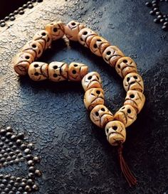 Tibet Buddhist prayer beads (traditionally called Malas). | Skull prayer beads made from carved yak bone (Ivory). | 17th  century. impermanence of life.Skull-shaped mala beads help chanters reflect upon the inevitability of death and the necessity of embracing lives filled with compassion.