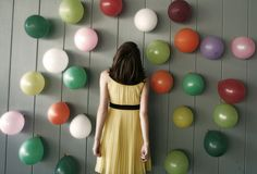 A balloon wall with confetti and treats inside. (A Subtle Revelry)