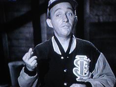 "Yes, this is from the Bells of St Mary- No, it is not photoshopped. Bing Crosby uses his middle finger while making a point to a bunch of kids - I find it exceptionally funny that his mouth is also making an ""F"" shape."