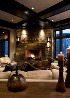 ceiling lights, candles, fire in fireplace, lighting fixtures on the stone fireplace