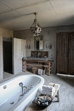 Rough stone. Floor tile from Castle Stones and the walls are from a whitewash of Pure Original. Furniture from Hoffz.