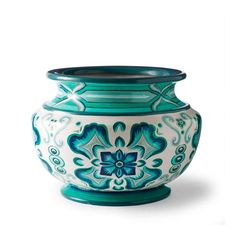 Inspired by the shades of the sea, our exquisitely detailed Serino Painted Planter with Handles brings a burst of cool color to your sunroom, patio or garden. Versatile enough for use inside or out, our wide-mouth vessels are constructed in durable polyester resin, styrene and fiberglass. Constructed of 72% polyester resin, 21% styrene, 7% fiberglass Handpainted  Includes drain hole and plug Wipe clean with soft, damp cloth or hose clean Handcrafted in the Philippines.