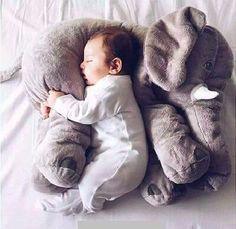 """Let baby get a good nap with a friend — this wonderful stuffed elephant that serves as a toy, pillow and comforter. Made of cotton with PP Cotton filling, 23.5"""""""