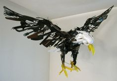 """Discarded objects"" flying bald eagle sculpture by Sayaka Ganz. Look closely--this majestic bird is made from dollar store plastic utensils! ""Born in Japan and living in Fort Wayne, Indiana, Sayaka Ganz has a BA in printmaking and an MFA in 3D Study with a concentration in sculpture from Bowling Green State University in Ohio. To create her sculptures, Ganz finds discarded objects including plastic utensils, toys, and metal pieces and gives them a second life and a new home."""