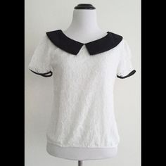 """Lace Peter Pan top with bows in the back ➖CONDITION: NWT ➖SIZE: medium (see measurements) ➖STYLE: a lace top w/ a Peter Pan collar that has elastic at the bottom. The top also has a black line down the middle with bows on the back   ➖MEASUREMENTS        ➖LENGTH: 19""""       ➖SHOULDER --> SHOULDER: 14.5""""       ➖BUST:17.5"""" Tops Blouses"""