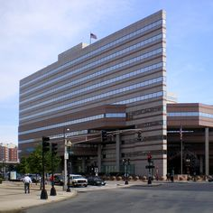 """GSA Region 1's Thomas P. O'Neill, Jr. Federal Building in Boston. Energy Star certified 2014.  A white reflective roofing system mitigates the """"heat island"""" effect and a large glass atrium in the center concourse lets in natural light. It's maintained with low-VOC paints, recycled-content metal studding, and recycled-content ceiling tiles. The Child Care facility uses 100% recycled-content equipment and 80% recycled-content rubberized surfacing for the play area."""