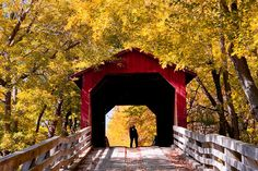 covered-bridge-kiss in autumn, magical moment. Reminds me of our trip to Madison county Iowa.