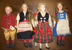 These dolls belong to Benita Suomi.  Doll doctor in Helsinki. Costumes from left to right, Askola boy, Carelian girl, Petalahti girl and Munsala girl.