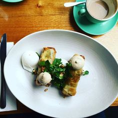 Blissful Sunday mornings with @saeashleigh enjoying Moroccan lamb & pine nut cigars with poached eggs, watercress, goats cheese and vegemite tahini dipping sauce along with a delicious @thegroundsofalexandria coffee  #cafe #breakfast #brunch #weekend #sunday #kepos #keposstreetkitchen #thegroundsofalexandria #sydney #redfern