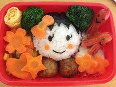 Japanese rice ball or 'japonica' with carrots, Nori, sausages, meatballs, scrabled egg, mixed veggies and brocolli.  [Created and prepared by Lhen Subong Kaitsuka]
