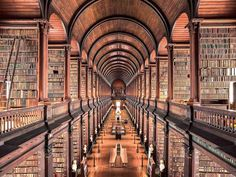 Trinity College Library, Dublin, 1732 Over the last year, photographer Thibaud Poirier has traveled across Europe to photograph some of the world's most incredible libraries. The series includes both historic and contemporary libraries with a special Trinity Library, Trinity College Dublin, Tadao Andō, World Library, Library Books, Beautiful Library, College Library, Dublin Library, Grand Library